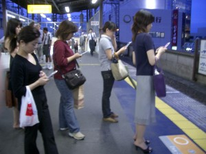 everyone-on-phones-at-platform-300x225